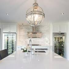 Kitchen With Two Glass Front Refrigerators