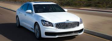 kia k900 exterior. Brilliant K900 2019 Kia K900 Exterior Shot White Driving Down Open Highway With Forest  Homes In The Background On Exterior E