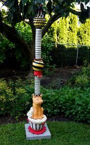 garden art outdoor high fire ceramic totem pole featuring cat bird sculpture