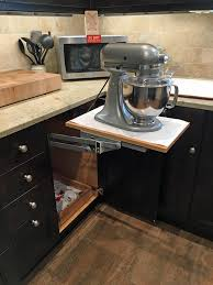 this mixer base provides sy support and easy storage of this heavy duty mixer along with storage for accessories on the roll out shelf below