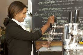 is hr required to post job openings internally bartender pouring a beverage during her shift as a seasonal employment at a restaurant
