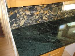 full height granite bacskplash with a soapstone countertop