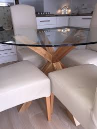 immaculate next oak and glass round dining table and 4 x matching sienna cream leather