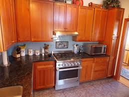 how to clean greasy wooden kitchen cabinets what can i use to clean my kitchen cabinets
