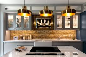 kitchen island lighting pictures. Brass Pendants Hang In A Row Of Three Above The Kitchen Island Lighting Pictures O