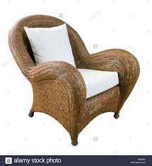 a large wicker chair with white cushions