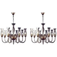two amber murano glass chandeliers with glass shades for