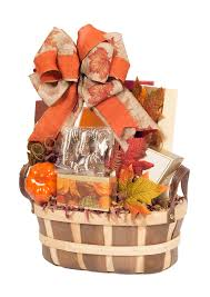 beautiful orange and brown autumn colors gift basket filled with a variety of goos isolated