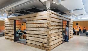 twitter san francisco office. two 19th century log cabins from montana help break up an awkward space at twitteru0027s san twitter francisco office o