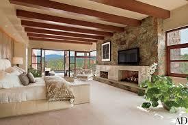 Charming Santa Fe Master Bedroom With Polished Alabaster Fireplace