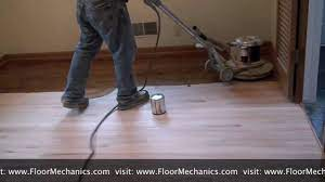 refinishing hardwood floors applying