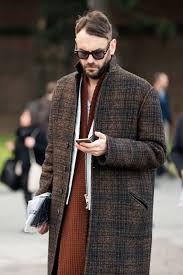 how to wear brown plaid overcoat white leather biker jacket knit scarf