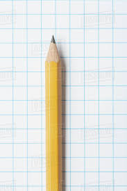 Close Up Of Single Yellow Sharpened Pencil On Graph Paper D1028_38_799
