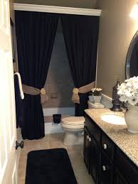 Curtain idea for bathroom with a shower curtain. Use 2 curtains instead of  one & cover that ugly curtain rod using crown molding.