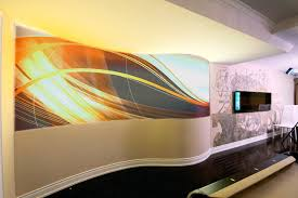 Curved Wall Feature Uses Stretch Ceiling to Become a Backlit Mural  eclectic-basement