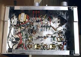 midcenturyradios com point to point wiring was used full wave rectifier is on left audio transformer is top left a triangular hole was punched out to reach tuning capacitor