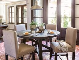 country rustic dining room with jaxon round extension dining table