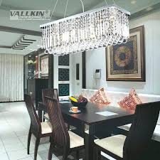 impressive swag chandelier over dining table