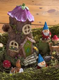 create a desktop fairy garden with gnomes woodland animals and other forest accessories