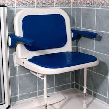 fold up padded shower seat with back and arms shown with blue cushions