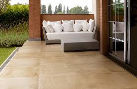 outdoor porcelain tile outdoor patio tiles over concrete sofa chair and table wooden floor