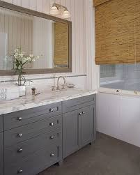 gray bathroom with white cabinets. gray cabinets look great against the white marble countertops bathroom with a