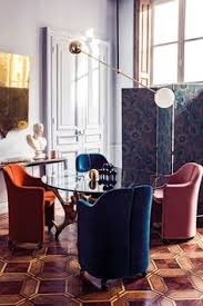 modern lighting round dining table and velvet chairs in this eclectic dining e