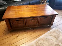 beautiful oak wood coffee table with baskets