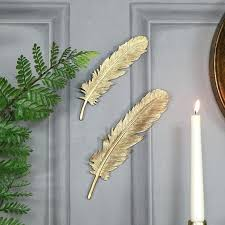 gold feather metal wall art