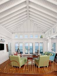 exposed beams and shiplap paneling on the soaring cathedral ceiling in this living room give the e a grand yet warm feeling reversing the direction of