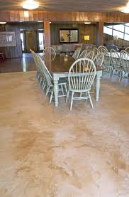 table and chairs in a dinning hall on a self leveling topped concrete floor
