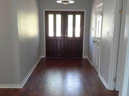 laminate wood and ceramic porcelain tile flooring foyer cache floor after chandelier crystal chandeliers gaz propane light companies bench modern living