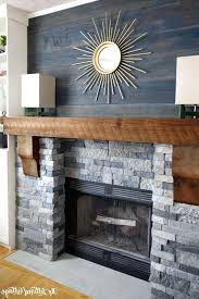 wood mantel on stone fireplace rough reclaimed wood mantel set above a traditional looking stacked stone