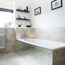 neutral bathroom with mirrored bath panel and neutral tiles