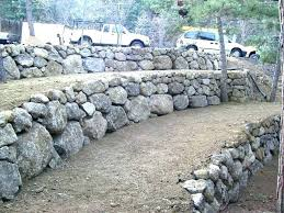 building a stone retaining wall on a slope how to build a rock retaining wall positive