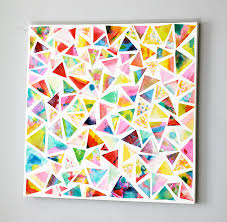 paint paper with watercolors let dry and cut into triangles pick triangles and glue