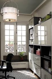 new york city family home trendy home office photo in new york with white walls and bookshelf file storage wall
