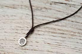 mini om necklace on brown cord