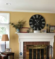 sherwin williams restrained gold paint color red brick fireplace country farmhouse style mantel decor