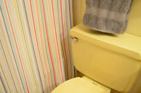 home is a 1970s apartment the guest bath kimberly ah bathroom yellow