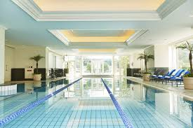 indoor gym pool. Simple Pool Indoor Pool With Royal Blue Chaise Lounges Potted Palm Trees And Floorto With Gym Pool O