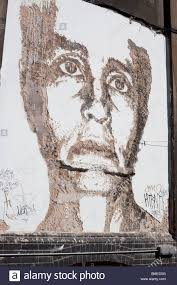 portrait chiseled into wall carved wall art by vhils tag name of portuguese artist alexandre farto in spitalfields london e1 england uk on wall art street names with portrait chiseled into wall carved wall art by vhils tag name of