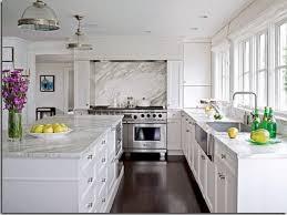 serene white kitchen design with light quartz countertop and long island plus bay window elegant