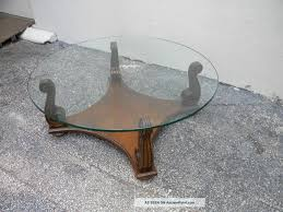 incredible round glass top coffee table with wood base with stainless steel table base modern living