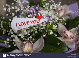 flowers and card with inscription love you valentines day background and love message love