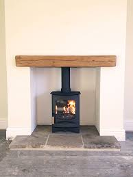 charnwood c four reclaimed yorkshire stone hearth oak fireplace beam log burner idea for study