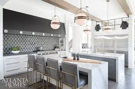 innovative custom features give the modern farmhouse kitchen a restaurant like quality that melds reiner s experience in commercial design