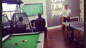 office game room. enjoying a game of footy in our games room badoo london england office