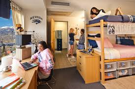 students hanging out in argenta hall room and bathroom area