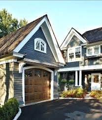 popular front door colors for brick houses r like the faux wood garage door against house